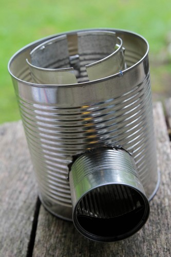 Make a hobo tin can portable rocket stove wnwpressrelease for Tin can rocket stove